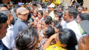 President visits flood victims