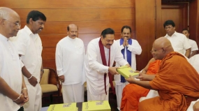"Book titled "" Siri Dalada Harasaraniya ""  presented to President"