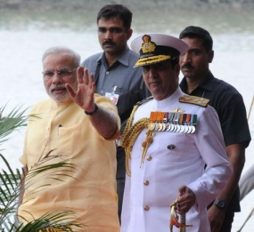 Prime Minister Narendra Mod,i with Chief of Naval staff Admiral R.K. Dhowan, arrivies for commissioning of INS Kolkata on Saturday.