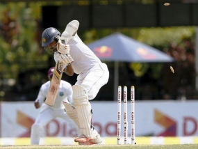 West Indies restricts Sri Lanka to 200