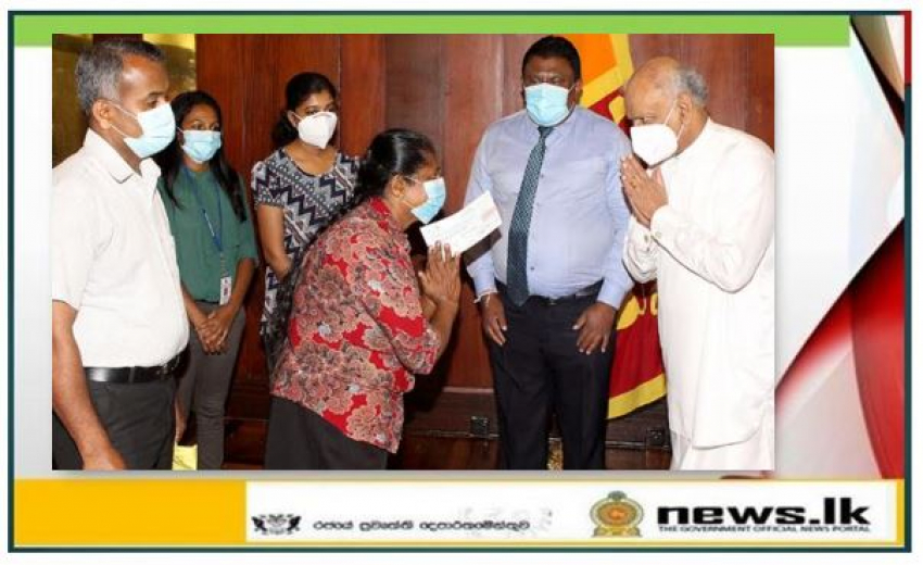 Handing over the cheque of Compensation to the Next of Kin of late Mr. K P Manjula Antony