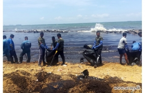 Troops rush to contain oil spill