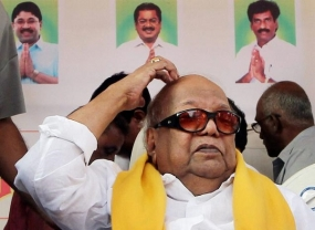Karunanidhi accepts defeat; congratulates Modi