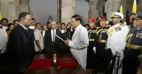 Maithripala Sirisena sworn in as New President and Ranil  as Prime Minister