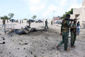 Suicide car bombing kills at least 6 near Somali parliament