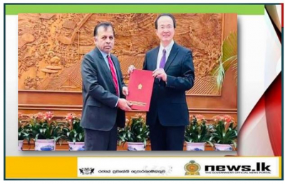Dr. Palitha  Kohona presents copy of the credentials to the DG of the Department of Protocol of the Ministry of Foreign Affairs of China