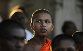 Sri Lankan government supporters hold oil lamps during a vigil condemning the U.S. backed resolution against Sri Lanka.|