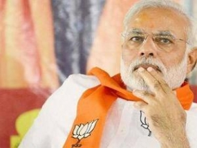 USD10,000 reward for serving summons to Modi