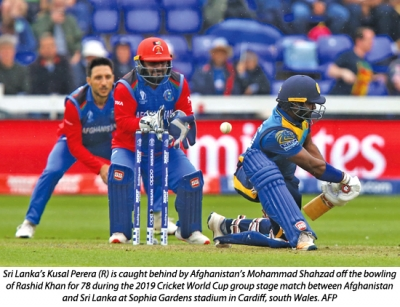 Lankan bowlers compensate for batting failure to eke out first win