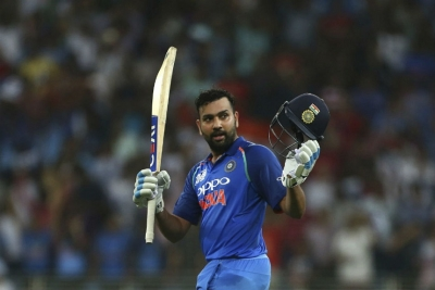 Sharma century guides India to opening World Cup win
