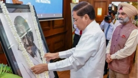President unveils Mahatma Gandhi portrait in commemoration of 150th birth anniversary