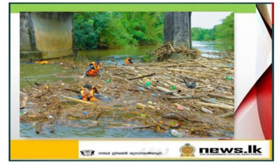 Naval personnel remove woody debris under Aviththawa Bridge
