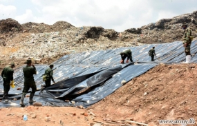 Meetotamulla garbage site covered with polythene