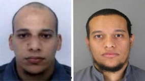 France hunts for 2 suspects; Nation mourns their victims