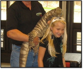 Pose for a photo with a reptile