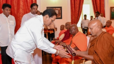 President hands 75 Temples title deeds of sacred premises