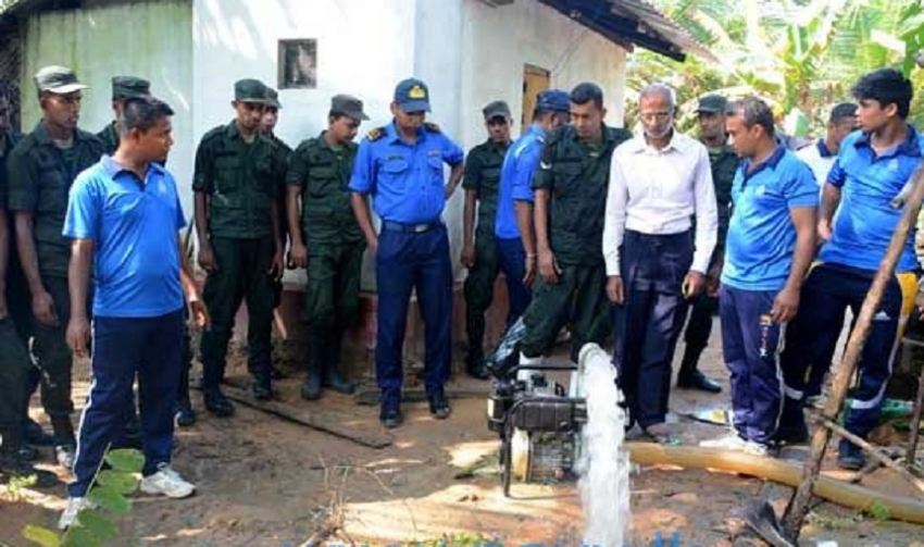 Navy assists cleaning drinking water wells in flood-hit North
