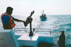Stranded fishermen rescued by Navy