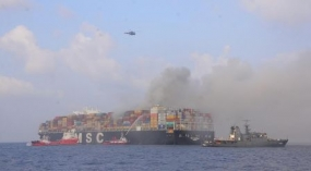 Navy assists to douse fire on container vessel