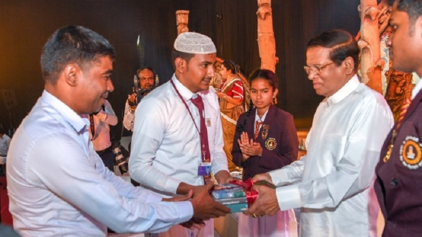President presents 'Polonnaruwa', academic volume, to school children and public