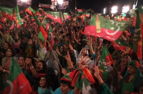 Supporters of Pakistan opposition leader Imran Khan attend a rally in Islamabad on Saturday