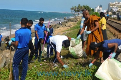 Naval personnel pitch in with beach cleaning