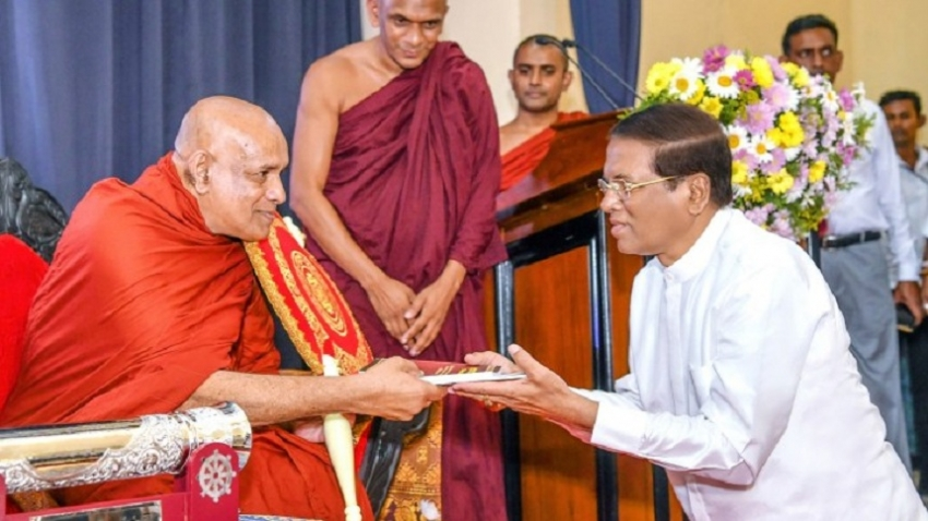 President presents Scroll to Anu Nayake Thero
